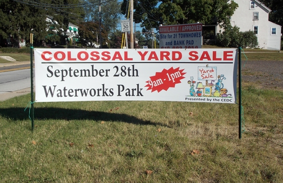 Photo by Heidi Jensen The sign for the colossal yard sale is located by the entrance of the Waterworks Park.