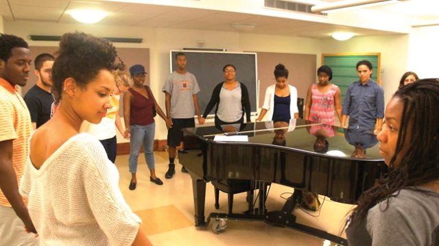 Photo courtesy of Monica Reuman The Gospel Choir, Voices in Praise, gather in a circle of prayer at one of their rehearsals. Their next performance is on Nov. 24 at 5:00 p.m.