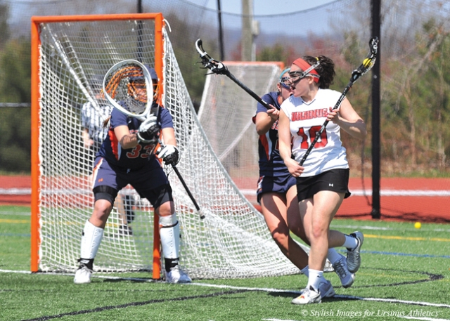 Photo courtesy of David Morgan/Stylish Images Inc Junior Kitty Dawson (10) cradles a ball and works toward the net in a match against Gettysburg. On Saturday, UC lost to Gettysburg 17-8.