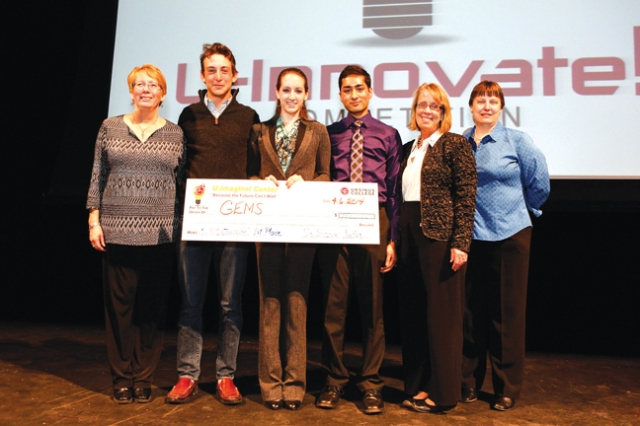 Photo courtesy of Brian Garfinkel  U-innovate winners and producers of the competition pose with their $7,500 check to go towards their idea.