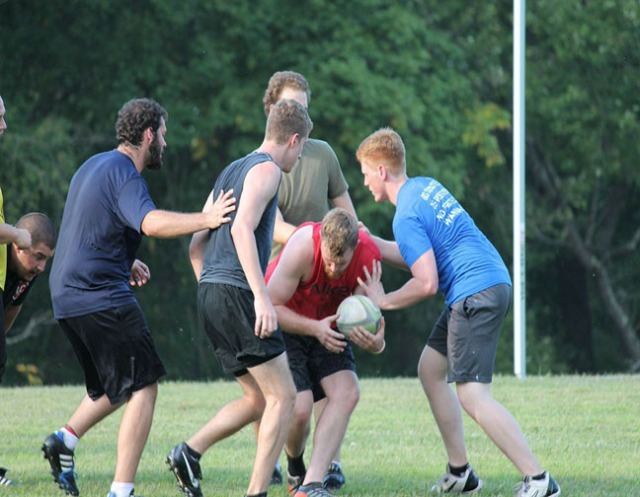"James ""Biff"" Wilson is seen here with the ball as the men's rugby team gears up for their upcoming season with a team scrimmage on Friday, Sept. 5."