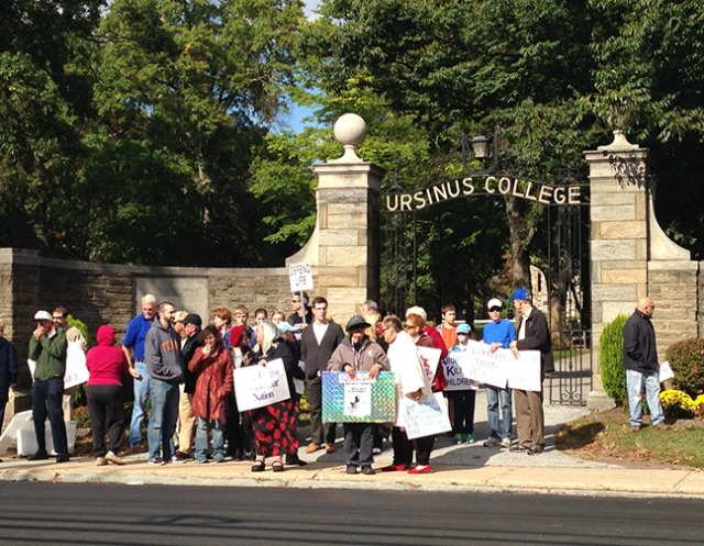 Photo courtesy of Rachel Brown Pro-life demonstrators gathered along Main Street on Oct. 5, outside of Ursinus's main gate. The protesters held various signs and remained silent as cars drove past the college.