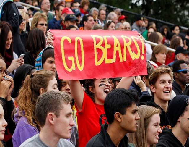 Photo courtesy of Ursinus College Communications Students and alumni collectively cheer for the Bears at the 2013 homecoming football game. This year's homecoming will take place on Oct. 25-26, and begin with the annual Grizzly Gala.