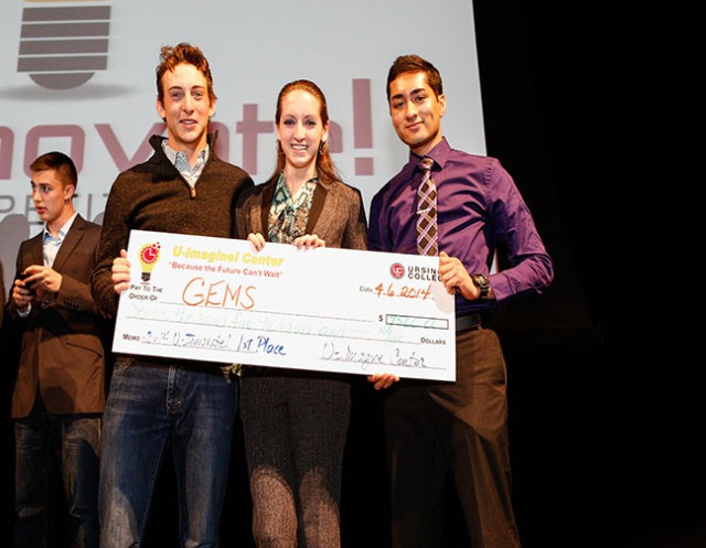 Photo courtesy of Ursinus College Communications / Brian Garfinkel Evan Lord, Aubrey Paris, and Samir Shah hold up their prize of $7,500 after placing first in the 2013 U-Innovate! competition.