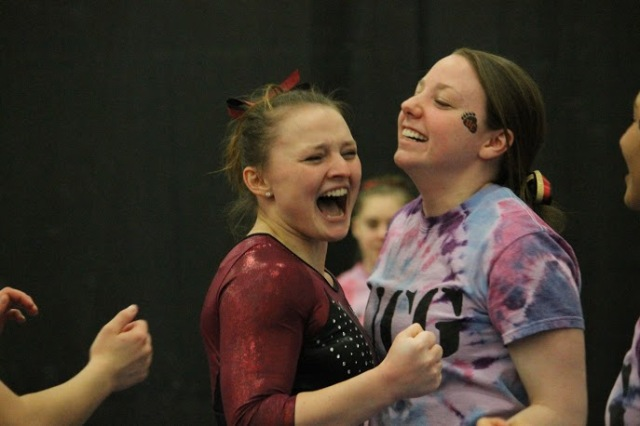 Photo courtesy of Jon Vander Lugt  Junior Tina Steffenhagen (left) is seen above celebrating with Tianna Lettieri after Steffenhagen finished on the vault on  Saturday, March 14.  Steffenhagen was named the NCGA East Gymnast of the Year.