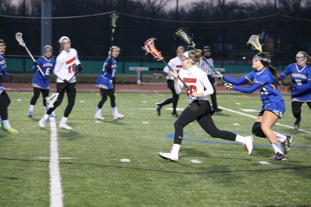 Photo courtesy of Jon Vander Lugt Amy Kouhout is seen above working her way past a Widener defender. The Bears won their March 18 matchup against the Pride 9-6 for their first win of the year. Kohout netted a hat trick, scoring three of the Bears' goals.